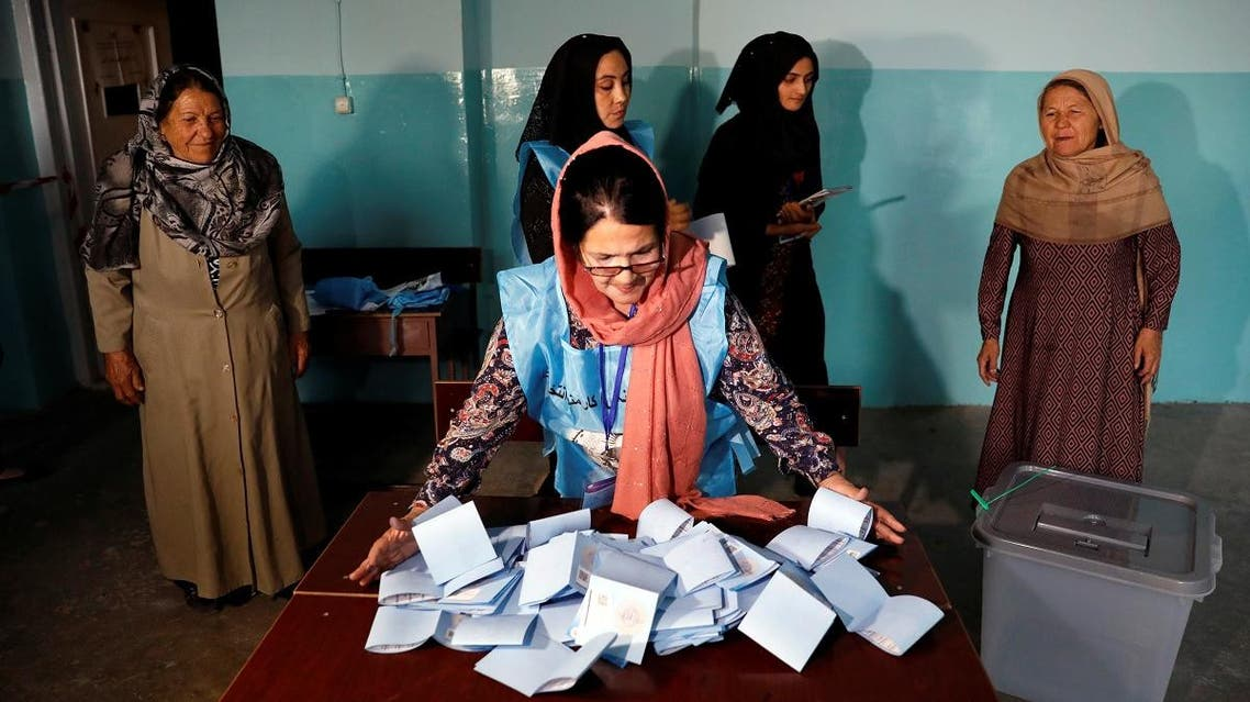 An Afghan election commission worker prepares ballot papers for counting of the presidential election in Kabul, Afghanistan. (Reuters)