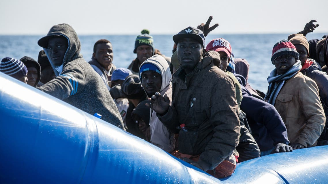 An unflatable boat with 47 migrants on board is pictured while being rescued by the Dutch-flagged Sea Watch 3 off Libya's coasts on January 19, 2019. The German charity group Sea Watch said on January 19 that it had rescued 47 migrants from an inflatable boat, but it was not known if they belonged to the same group that was feared missing off the Libyan coast, the International Organization for Migration said on January 19 after the Italian navy flew three survivors to the Mediterranean island of Lampedusa.