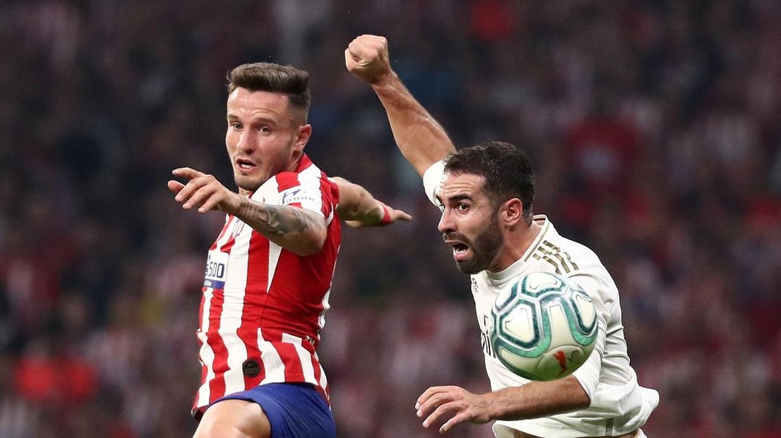 Real Madrid's Dani Carvajal in action with Atletico Madrid's Saul Niguez. (Reuters)
