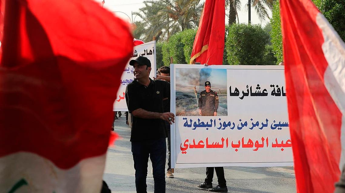 In this Saturday, Sept. 28, 2019, photo, protesters gather during a demonstration to support Lt. Gen. Abdul-Wahab al-Saadi, in the poster, in Baghdad, Iraq.  (AP)