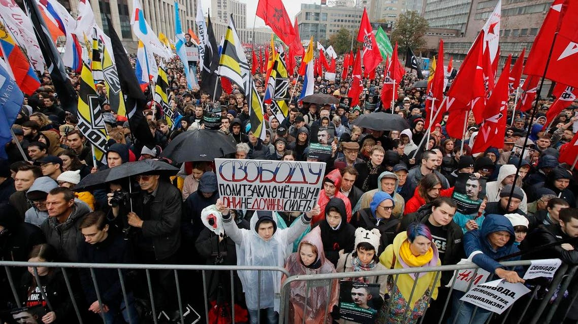 """A protester holds a banner reading """"Freedom to political prisoners! They haven't to be arrested!"""" during a rally to support political prisoners in Moscow, Russia, Sunday, Sept. 29, 2019. (AP)"""