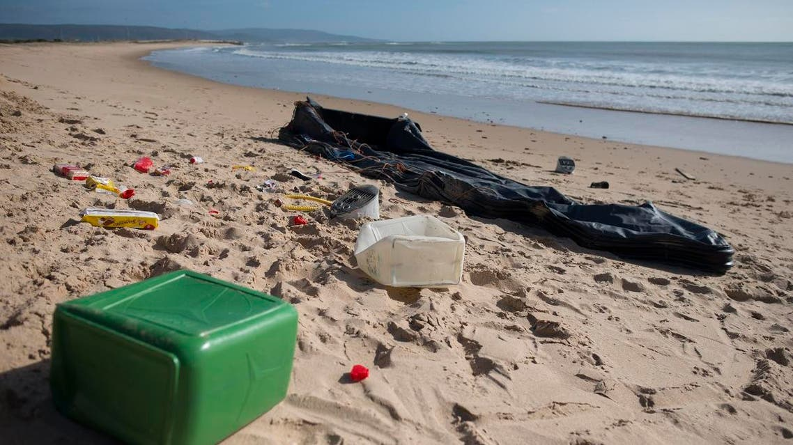 Rests of an inflatable boat used by migrants lies on the Hierbabuena beach in Barbate on November 26, 2018. (AFP)