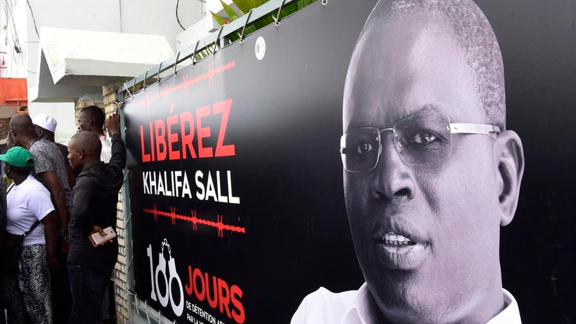 A banner with a picture of Dakar's mayor Khalifa Sall, in jail awaiting trial for what supporters say are politically motivated embezzlement charges, is on display in front of his offices in Dakar on July 31, 2017. (AFP)