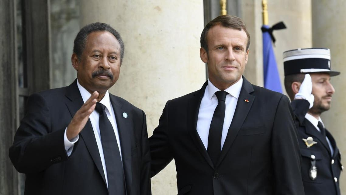 French President Emmanuel Macron (R) poses with Sudan's Prime Minister Abdalla Hamdok ahead of a meeting at The Elysee Presidential Palace in Paris on September 30, 2019. (AFP)