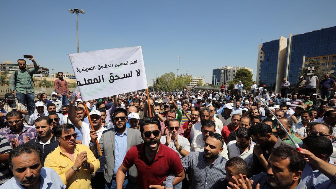 Public school teachers take part in a demonstration near the Prime Ministry demanding a pay raise in Amman, Jordan, September 5, 2019. Picture taken September 5, 2019. REUTERS