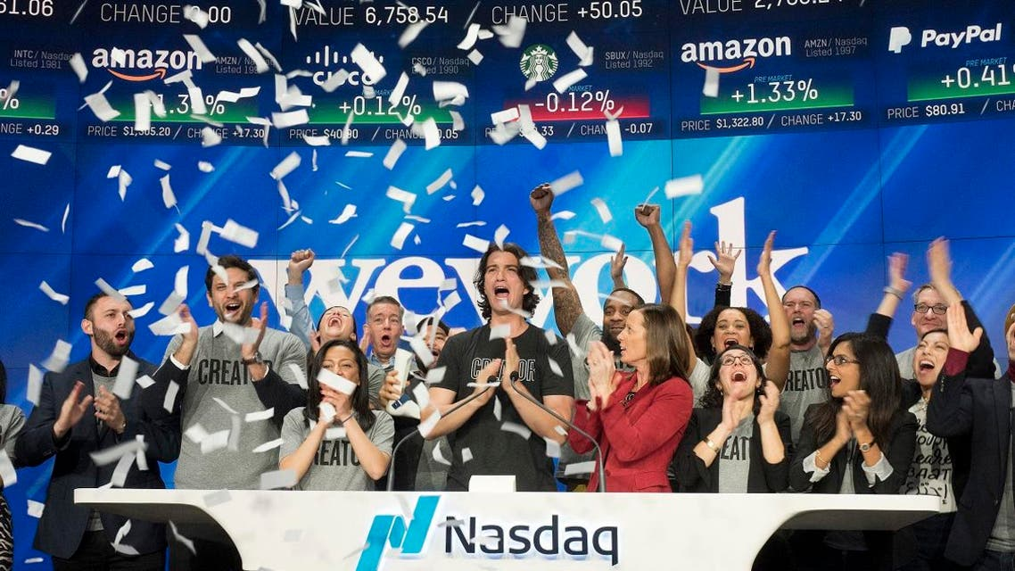 In this Jan. 16, 2018 file photo, Adam Neumann, center, co-founder and CEO of WeWork, attends the opening bell ceremony at Nasdaq in New York. (AP)