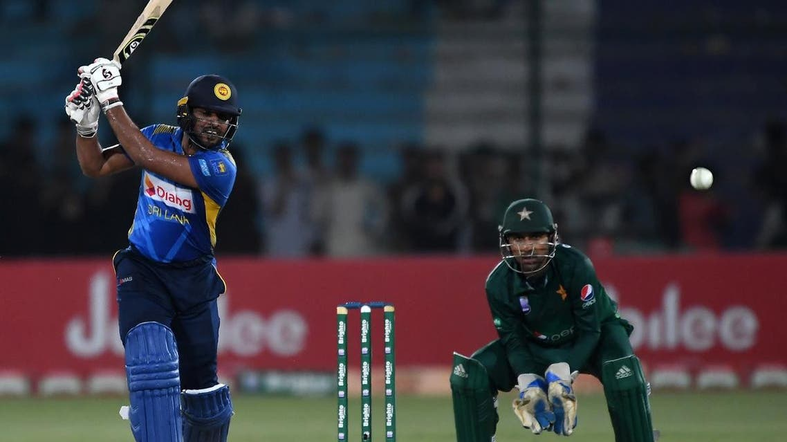 Sri Lanka's batsman Shehan Jayasuriya (L) plays a shot as Pakistan's captain and wicketkeeper Sarfraz Ahmed looks on during the second one day international (ODI) cricket match between Pakistan and Sri Lanka at the National Cricket Stadium in Karachi on September 30, 2019. (AFP)