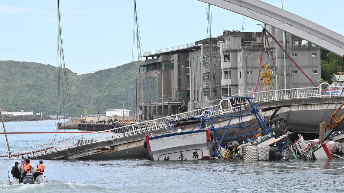 A fishing boat is pictured after it was crushed when a bridge collapsed in Nanfangao harbour in Suao township on October 1, 2019. (AFP)