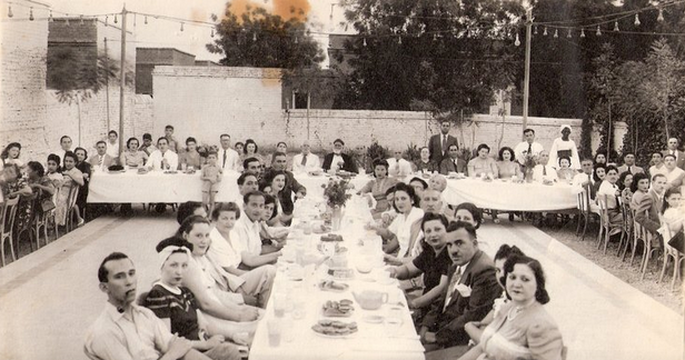 Jewish families celebrating the Sukkot holiday at a recreational club in Sudan. (via Tales of Jewish Sudan)