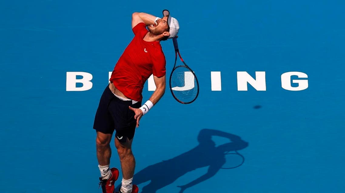 Andy Murray of Britain prepares to serve against his compatriot Cameron Norrie during their second round of the men's singles match in the China Open. (AP)
