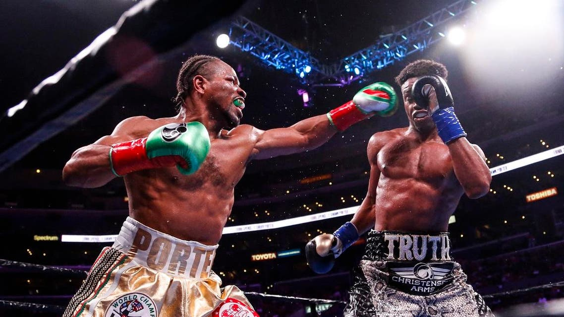 Shawn Porter, left, and Errol Spence Jr. exchange punches during the WBC & IBF World Welterweight Championship boxing match. (File photo: AP)