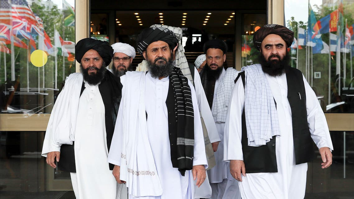 FILE PHOTO: Members of a Taliban delegation, led by chief negotiator Mullah Abdul Ghani Baradar (C, front), leave after peace talks with Afghan senior politicians in Moscow, Russia May 30, 2019. REUTERS/Evgenia Novozhenina/File Photo