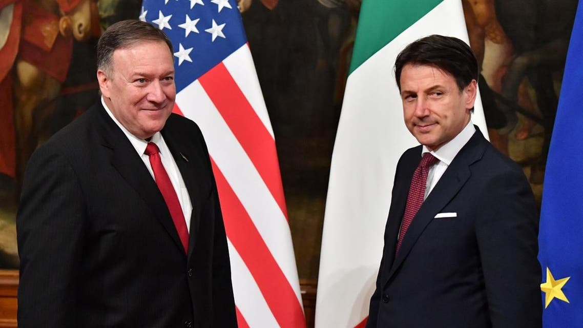 """US Secretary of State Mike Pompeo (L) and Italy's Prime Minister Giuseppe Conte look on as Italian journalist Alice Martinelli from Italy's Mediaset television programm """"Le Iene"""" (The Hyenas), (not in picture) interrupts them during Conte and Pompeo's meeting on October 1, 2019 at Palazzo Chigi in Rome, at the start of Pompeo's four-nation tour of Europe. (AFP)"""