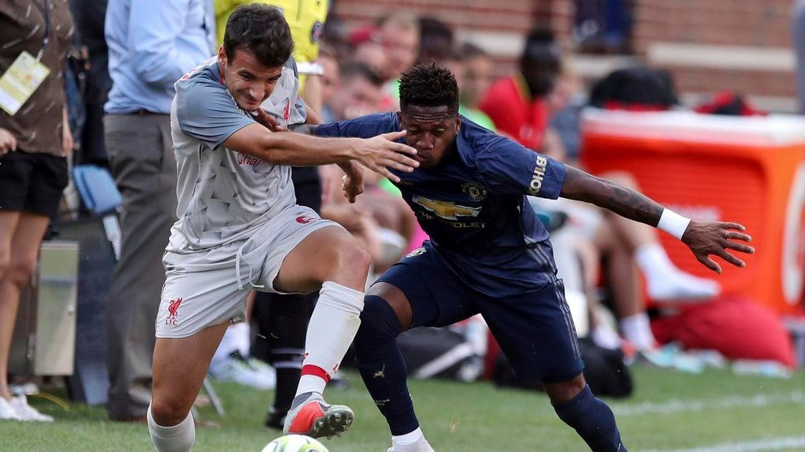 Liverpool midfielder Pedro Chirivella, left, and Manchester United midfielder Fred battle for the ball during the second half of an International Champions Cup tournament soccer match. (AP)