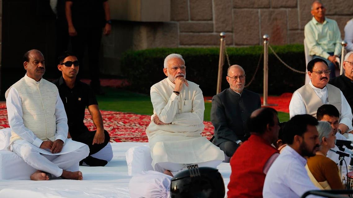 Indian Prime Minister Narendra Modi, center, attends an event to pay tribute to iconic independence leader Mahatma Gandhi on the 150th anniversary of his birth in New Delhi, India, Wednesday, Oct. 2, 2019. (AP)