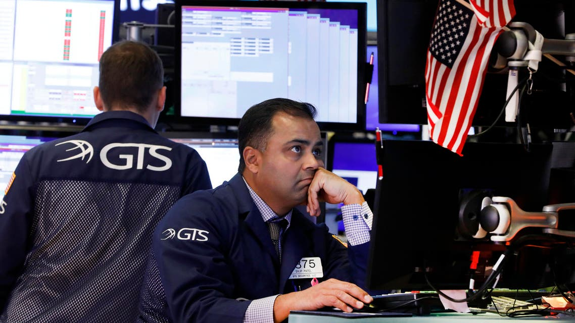 Specialist Dilip Patel, right, works on the floor of the New York Stock Exchange, Wednesday, Oct. 2, 2019. (AP)