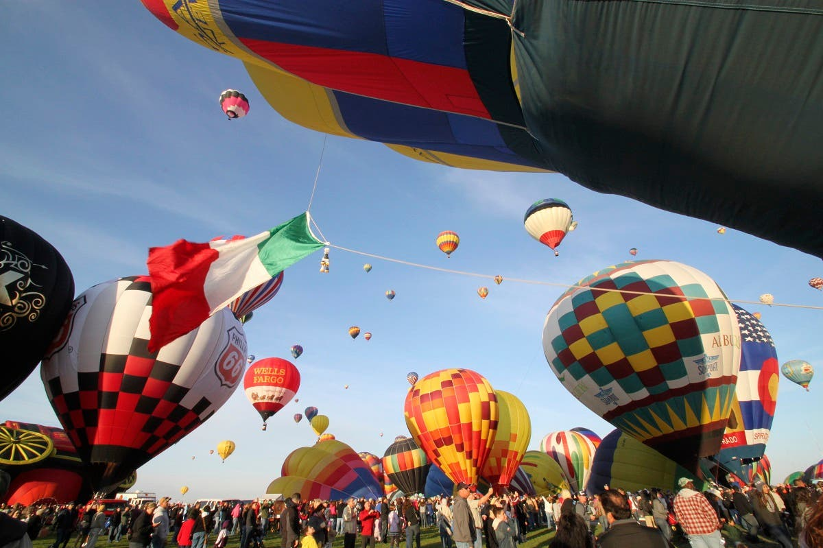 In this October 2, 2011, file photo, thousands of spectators mingle among inflating hot air balloons at the 40th Albuquerque International Balloon Fiesta in Albuquerque. (AP)