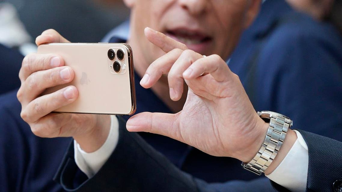 Apple team members demo the new cameras on iPhone 11 Pro for guests during an event to announce new products on Sept. 10, 2019, in Cupertino, California. (AP)