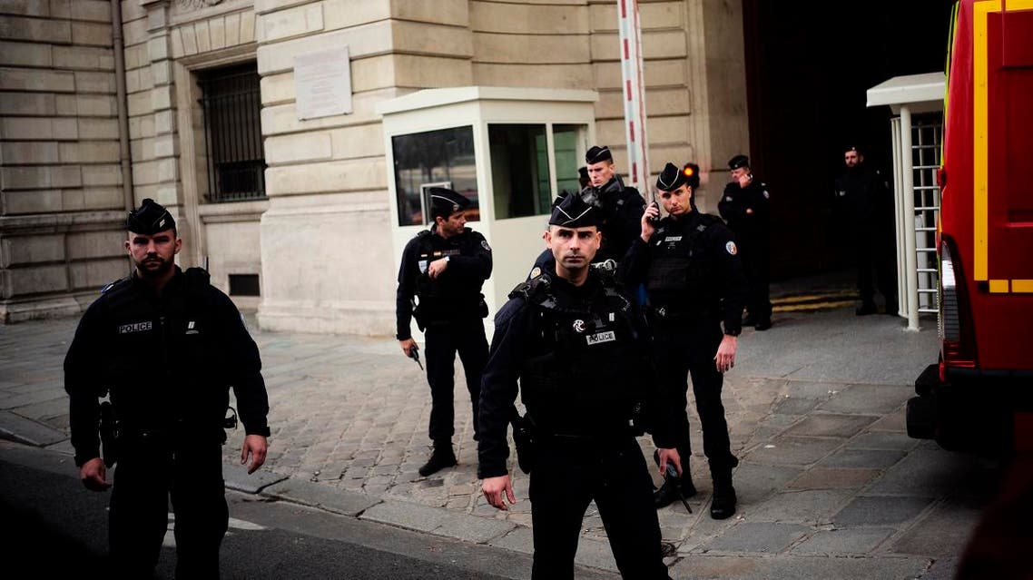 Police officers stand outside the Paris police headquarters, Thursday, Oct.3, 2019 in Paris. (AP)