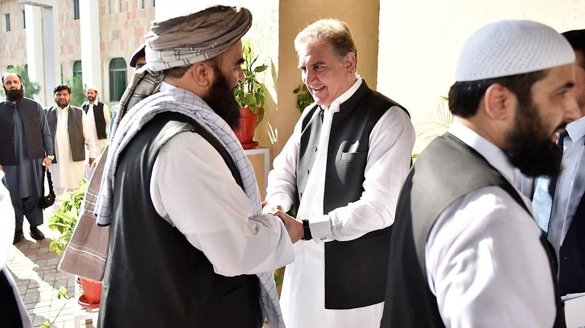 Pakistan's Foreign Minister Shah Mehmood Qureshi (center), receives members of Taliban delegation in Islamabad on October 3, 2019. (AP)
