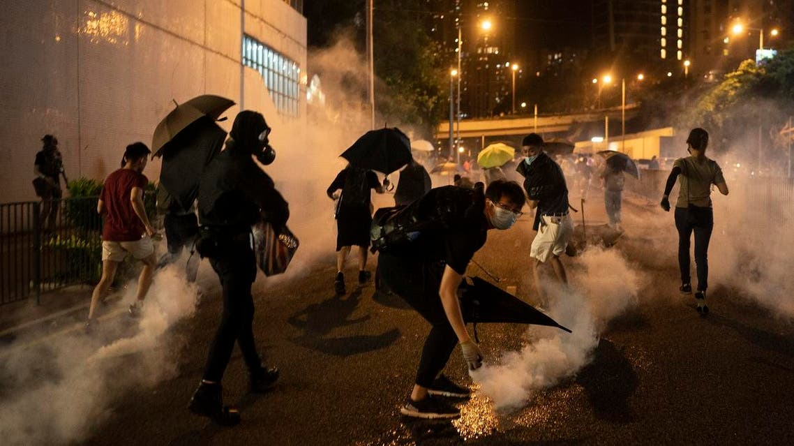 Protesters run away after police fired tear gas during a demonstration near Tai Koo station in Hong Kong, on Oct. 3, 2019. (AP)