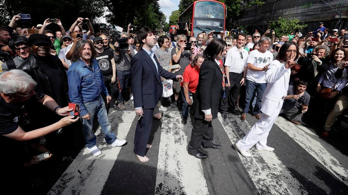 Fans dressed as lookalikes walk acrossFans dressed as lookalikes walk across the Abbey Road zebra crossing on the 50th anniversary of British pop musicians The Beatles doing it for their album cover of 'Abbey Road' in St Johns Wood in London. (AP) the Abbey Road zebra crossing on the 50th anniversary of British pop musicians The Beatles doing it for their album cover of 'Abbey Road' in St Johns Wood in London. (AP)
