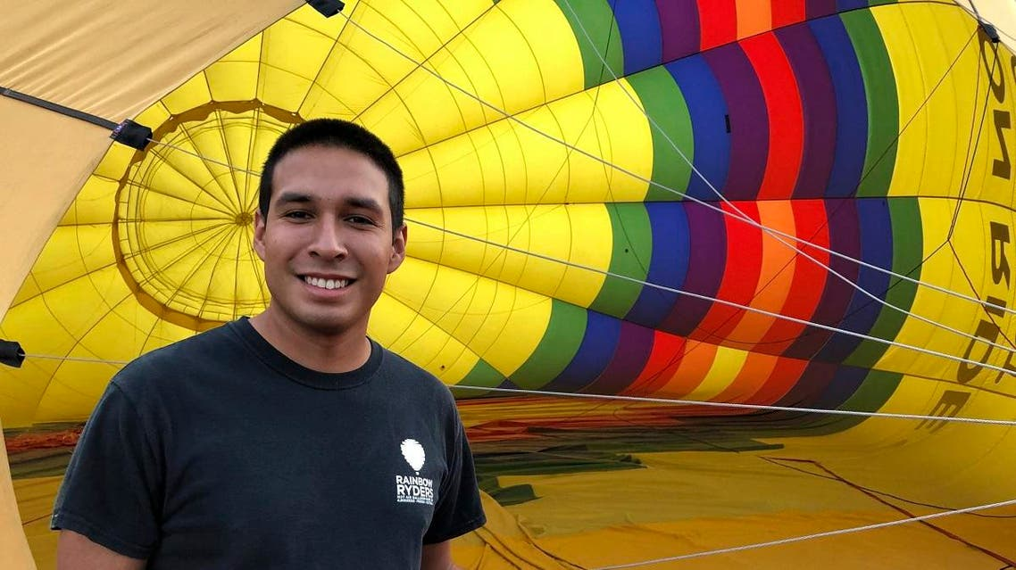 Elijah Sanchez poses for a photo while inflating a hot air balloon in Albuquerque, New Mexico, on October 1, 2019.  (AP)