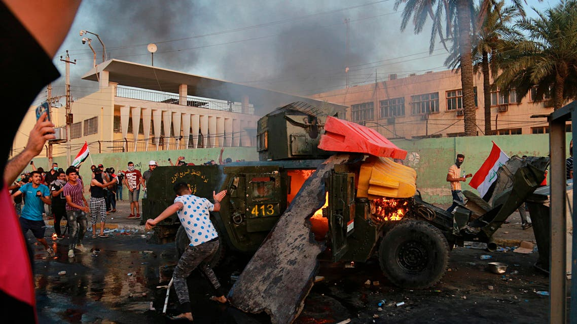 Anti-government protesters burn an armored vehicle belonging to the Federal Police Rapid Response Forces during a protest in Baghdad, Iraq, Thursday, Oct. 3, 2019. (AP)