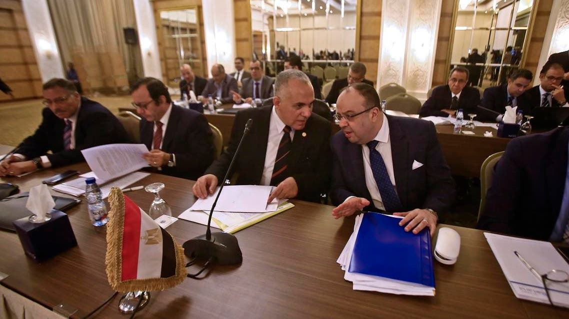 """Egyptian Water Resources Minister Mohamed Abdel Aati (2nd R) participates with a delegation in the """"Renaissance Dam"""" trilateral negotiations with his Sudanese and Ethiopian counterparts (unseen) in the Sudanese capital Khartoum on October 4, 2019. (AFP)"""