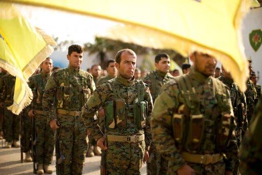 قوات من سوريا الديمقراطية في الباغوز (أرشيفية- أسوشييتد برس)