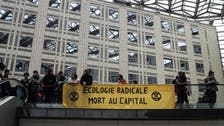 Climate activists block a Paris mall in call for action