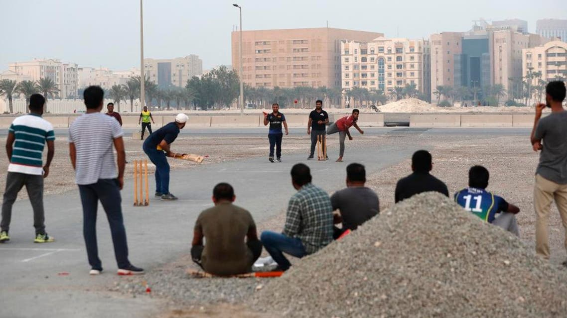 People play cricket on a patch of wasteland in Doha, Qatar, Friday, Oct. 4, 2019. AP