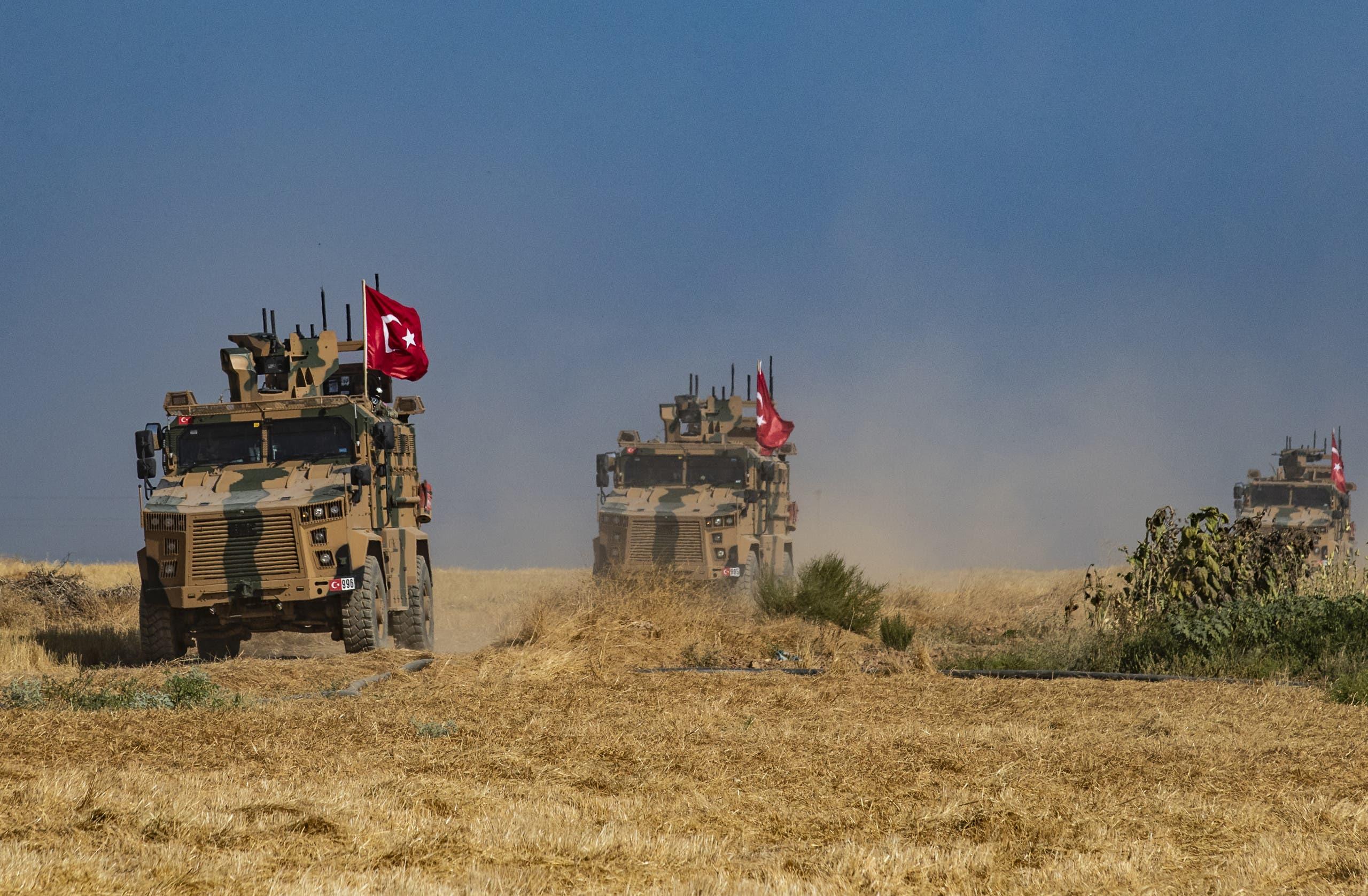 آليات عسكرية تركية في تل أبيض شرق الفرات (أرشيفية- فرانس برس)