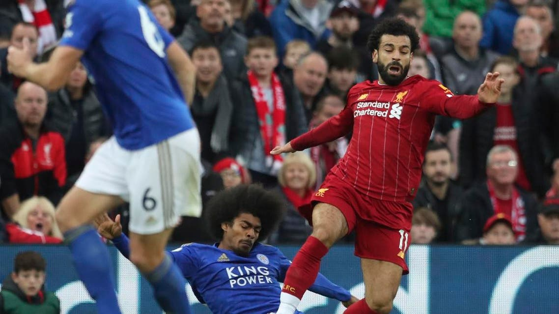 Leicester City's Hamza Choudhury fouls Liverpool's Mohamed Salah during English Premier League soccer match in Anfield stadium in Liverpool, England, on Oct. 5, 2019. (AP)