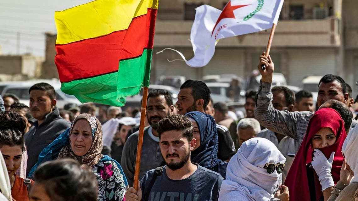 Syrian Kurds wave Kurdish flags during a demonstration against Turkish threats in the town of Ras al-Ain in Syria's Hasakeh province near the Turkish border on October 6, 2019. (AFP)