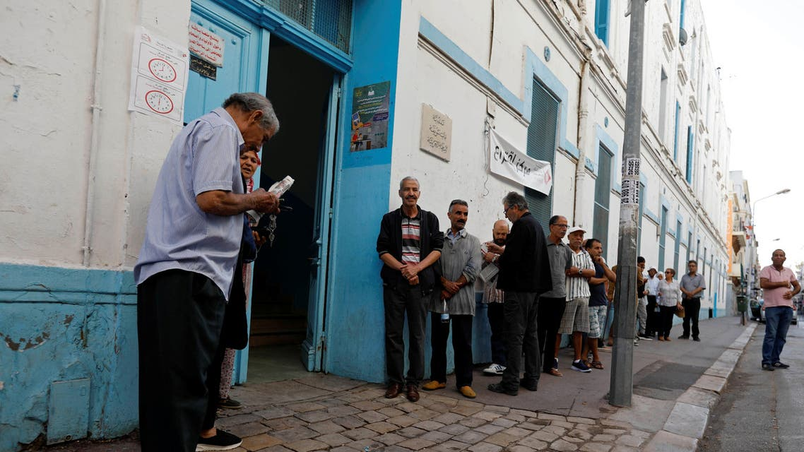 People wait to cast their votes outside a polling station during parliamentary elections, in Tunis, Tunisia October 6, 2019. REUTERS