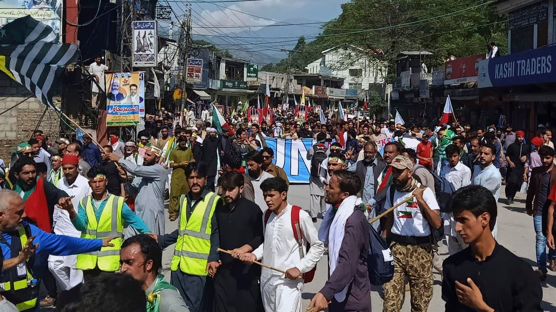 Supporters of Jammu Kashmir Liberation Front start marching toward the Line of Control, in Muzaffarabad, the capital of Pakistani Kashmir, Saturday, Oct. 5, 2019.