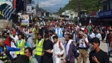 Police block thousands marching in Pakistani Kashmir