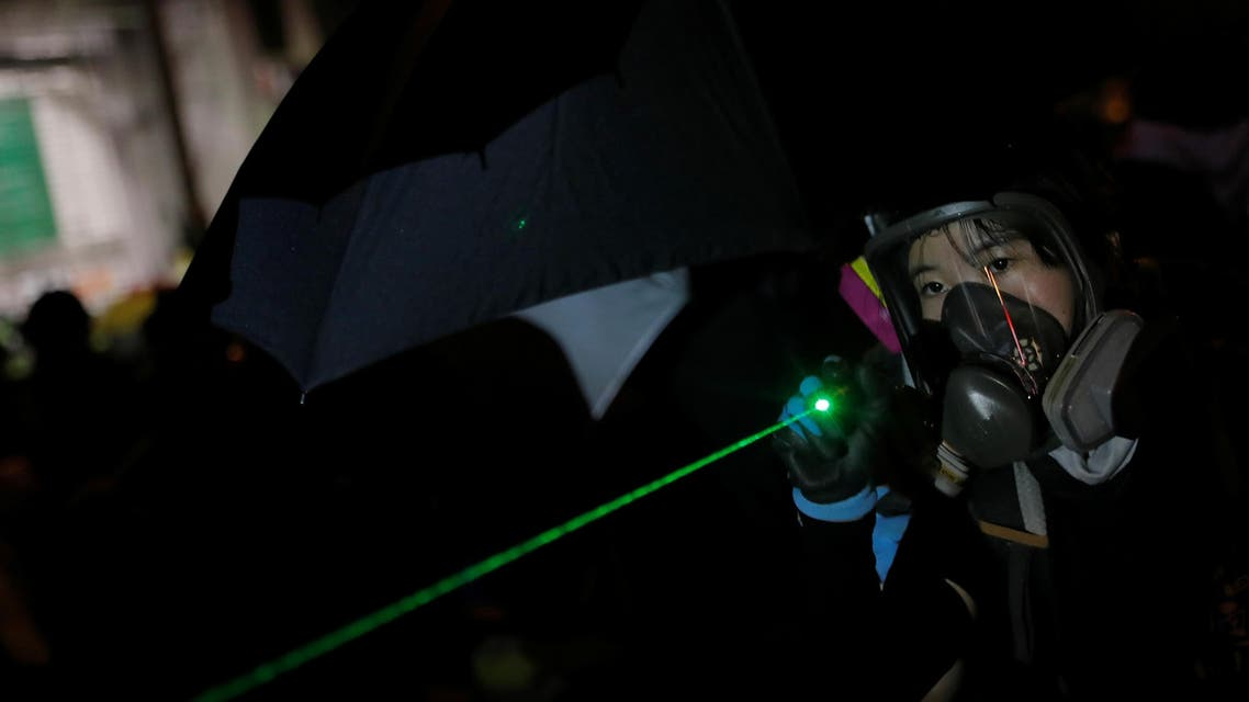 An anti-government protester uses a laser pointer during a demonstration in Admiralty district, Hong Kong, China, September 29, 2019. REUTERS