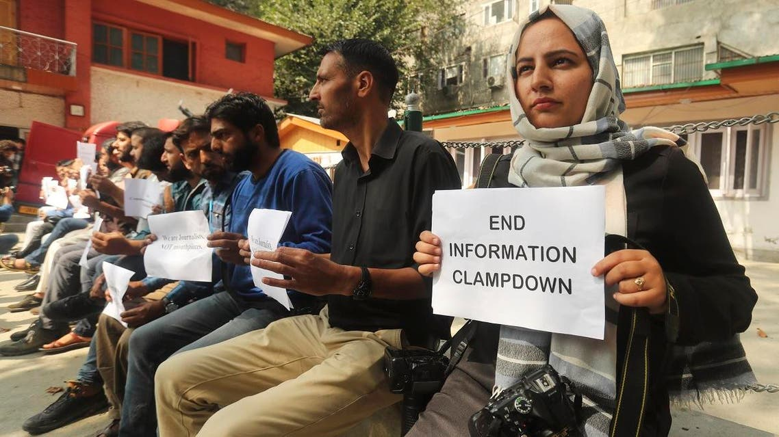 Kashmiri journalists display placards during a protest against the communication blackout in Srinagar, Indian controlled Kashmir, on Oct. 3, 2019. (AP)