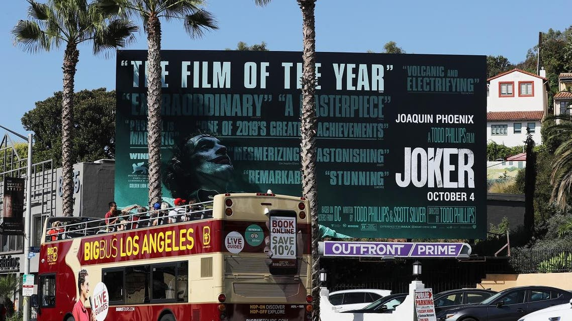 A tour bus passes a billboard displayed for the new film 'Joker' on October 3, 2019 in West Hollywood, California. (AFP)