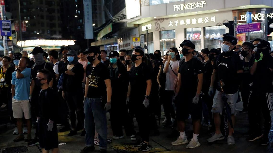 Anti-government protesters wear masks during a demonstration following a government's ban on face masks under emergency law, at Yuen Long, in Hong Kong. (Reuters)