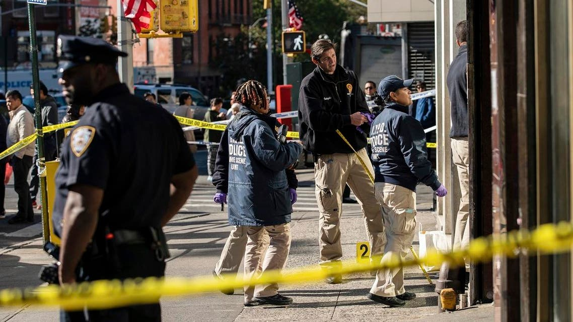 New York Police Department officers investigate the scene of an attack in Manhattan's Chinatown neighborhood, on October 5, 2019 in New York. (AP)