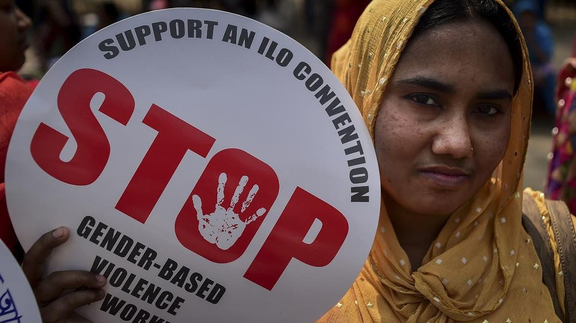 A Bangladeshi woman holds a placard as she takes part in a rally to mark International Women's Day in Dhaka on March 8, 2019. (AFP)