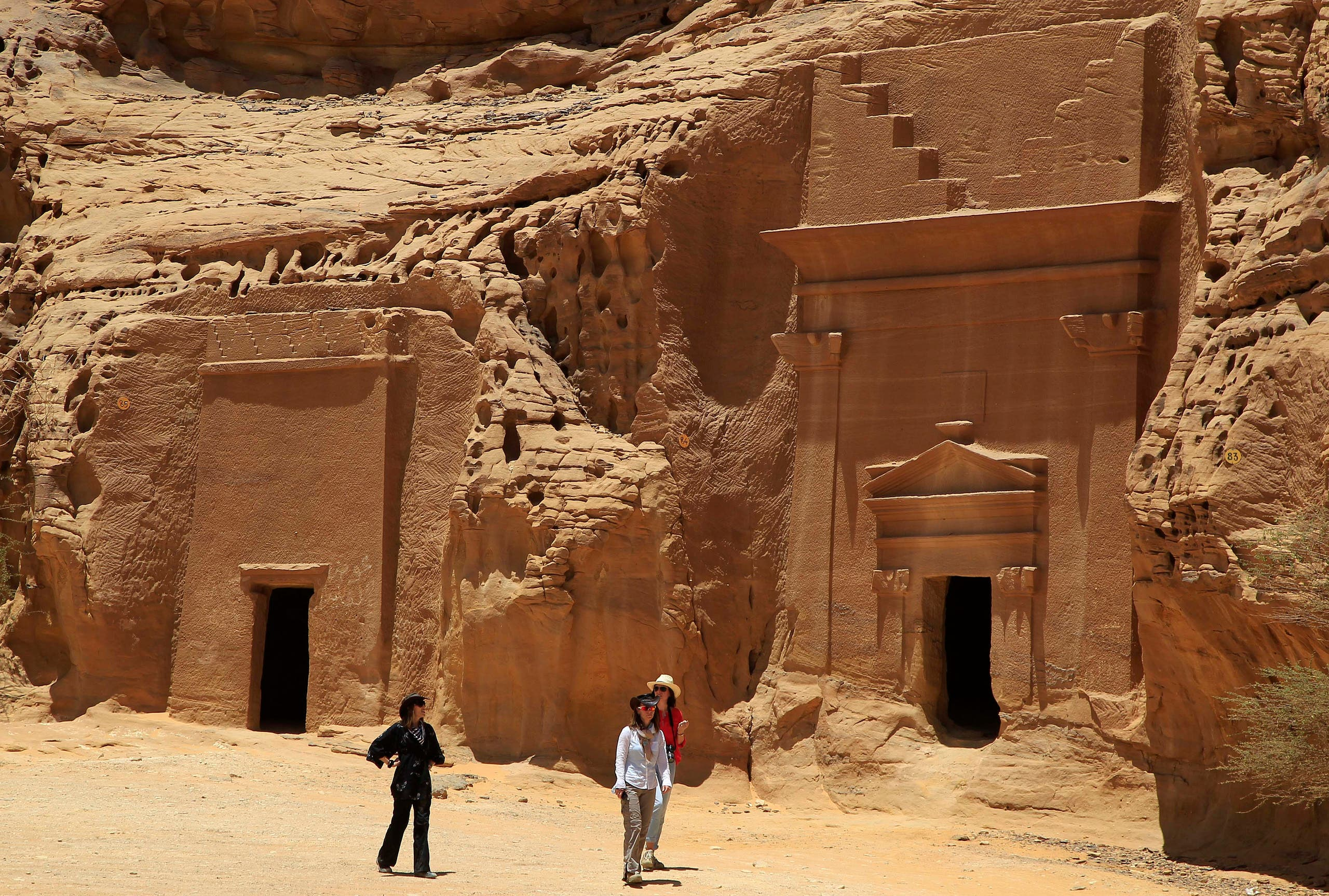 Foreign tourists visit a Nabataean tombs complex in the desert archaeological site of Madain Saleh, in Al Ula, Saudi Arabia on May 10, 2012. (AP)