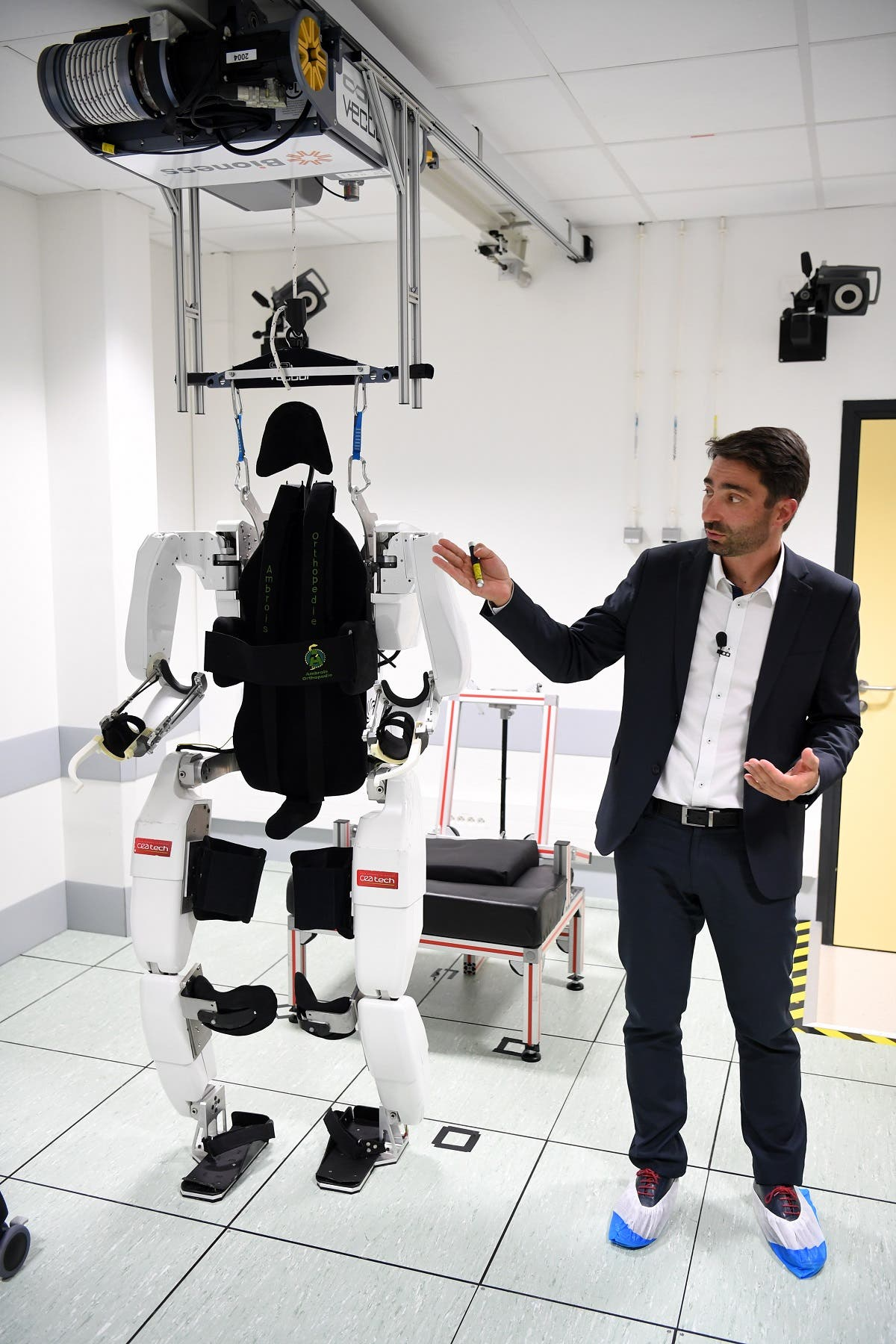 French project manager Gullaume Charvet presents the brain-controlled exoskeleton that allowed a disabled patient to walk again at the biomedical research center Clinatec in Grenoble on October 7, 2019. (AFP)