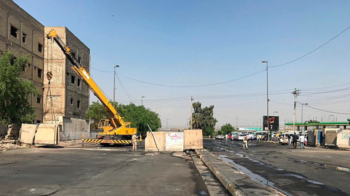 Iraqi security forces remove concrete blast walls that were cutting the streets in the protest site area of Baghdad, a day after calm was restored in the Iraqi capital, on October 8, 2019. (AP)