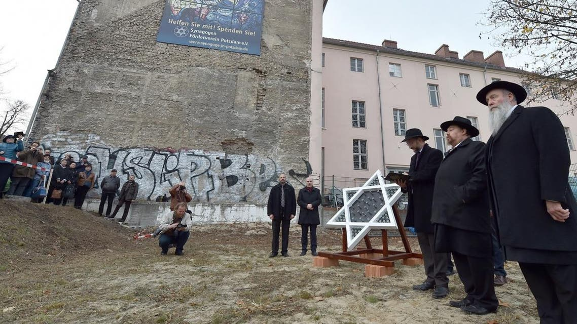 Residents of Potsdam, eastern Germany, attend a ceremony at the construction site of a new synagogue on November 9, 2018, the 80th anniversary of the Kristallnacht Nazi pogrom. (AFP)