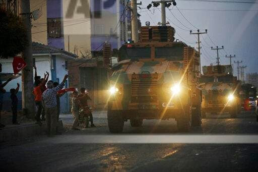 Turkish forces vehicles being driven through the town of Akcakale, Sanliurfa province, southeastern Turkey, at the border between Turkey and Syria, on October 9, 2019. (AP)