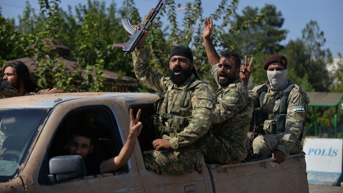 عناصر من فصائل سورية مسلحة موالية لأنقرة - رويترز